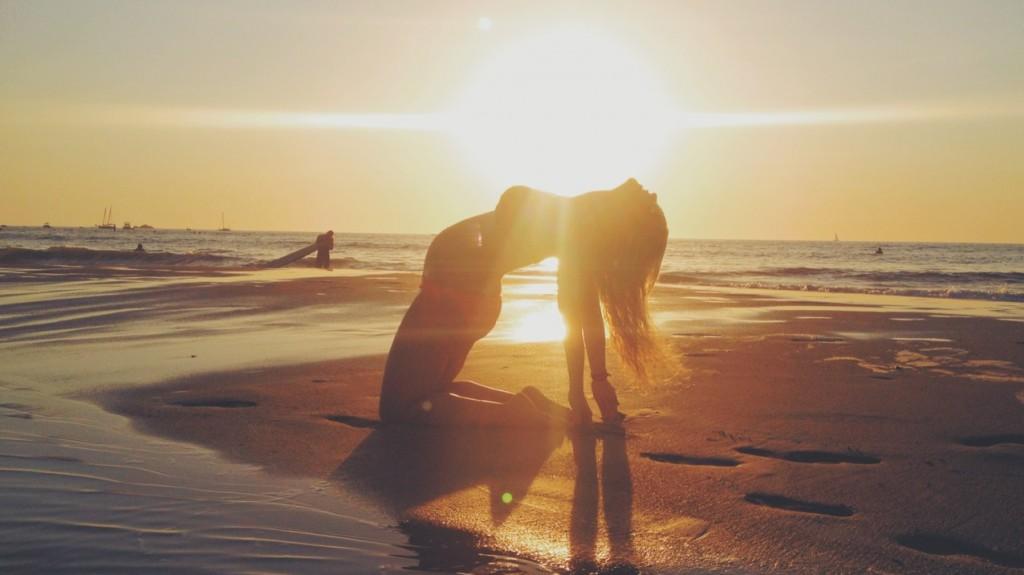 pregnancy yoga on the beach